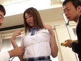 Schoolgirl Yui Tatsumi takes on two cocks in hardcore picture 11