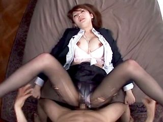 Kinky office lady in ripped pantyhose Tsubasa Amami gives a foot job