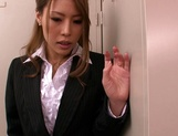 Horny Asian office babe, Haruka Sanada gives a nice handjob picture 7