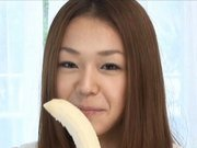 Sakura Hirota Naughty Asian model enjoys a banana to suck