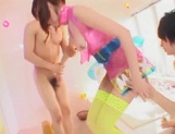 Horny young Japanese AV Model with pigtails sucks two dicks