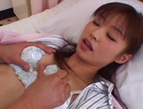 Horny Japanese AV Model gets fucked hard on a hospital bed picture 15
