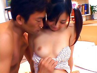 Japanese AV model with small teen tits enjoys fingering