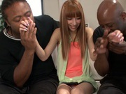 Two black males are ready for young Riho Hasegawa