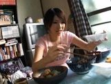 Lala Suzumiya Japanese model sucks cock in the kitchen after dinner picture 4