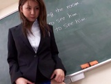 Sexy Asian teacher Yui Tatsumi masturbates in front of class picture 15