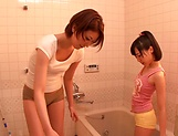 Horny lesbian babes Ryo Sena, and Rabu Saotome have fun in the bathroom picture 15
