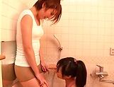 Horny lesbian babes Ryo Sena, and Rabu Saotome have fun in the bathroom