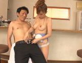 Frisky Japanese milf gives a handjob and sucks rod picture 12