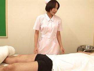 Lustful Japanese nurse Ayako Kanou jerks off cock and masturbates