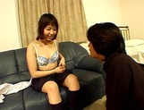 Asian schoolgirl Riho Yuzuki poses naked and gets a dildoed