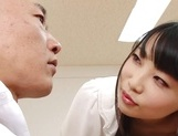 Appealing Japanese AV model seduces a cute bald guy gives a foot job picture 11