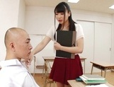Appealing Japanese AV model seduces a cute bald guy gives a foot job picture 7