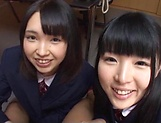 Two teen schoolgirls star in luscious blowjob picture 12