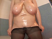 Ravishing hot Japanese milf oils her fatty torso