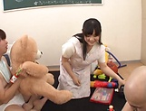 Busty babe Yatsuka Mikoto handles two cocks
