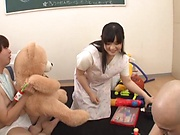 Busty babe Yatsuka Mikoto handles two cocks