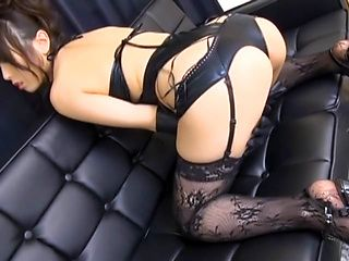 JP Milf in black stockings Chika Arimura gives a foot job and a hand work