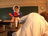 Pretty Asian schoolgirl in a fancy costume enjoys rear fuck
