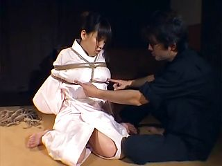 Tied up hottie with bubble ass Megumi gets hot wax on body
