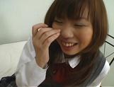 Japanese schoolgirl, Misa Kurita bends over for cock in her twat picture 15