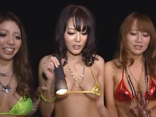 Three cock starved Asian chicks in bikinis attack hard cock of a guy