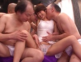 Sweet Japanese chick with small tits Nanami Kawakami in a gangbang action picture 12
