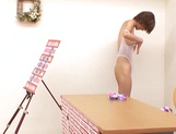 Pretty Japanese milf in transparent lingerie Akari Asahina jerks off cock picture 14
