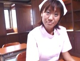 Naughty Asian nurse, Reimi Aoi, is a horny milf when it comes to fucking picture 1