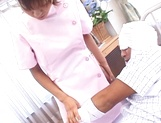 Naughty Japanese nurse is one hot milf with her patients picture 11