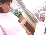 Naughty Japanese nurse is one hot milf with her patients picture 13