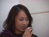 Big-tittied Asian lady in nylon pantyhose masturbates her pussy