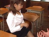 Horny Japanese teacher gives head and provides a hot hand job