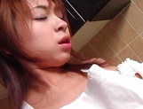 Lovely Asian housewife enjoys solo fingering in the kitchen picture 14