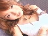 Japanese AV Model Enjoys Getting A Load Of Cum On Her Tits picture 12