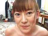 Cute MILF Minami Hoshikawa gives her hubby a nice tit fuck picture 12