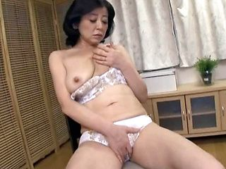 Mature Asian woman Chizubu Terashima masturbates hard on a chair