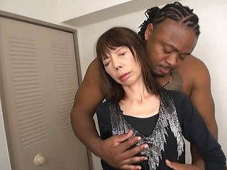 Massive black dude with big cock screws a lustful Japanese milf
