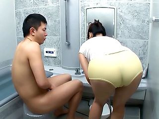 Fetching mature Japanese AV Model sucks cock in the bathroom