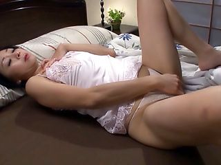 Erotic Japanese AV model masturbates mature twat