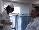 Hot Japanese nurse spreads legs for a huge cock picture 4
