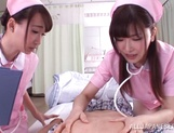 Appealing nurses Caire Hasumi and Anri Okita share hard cock picture 12