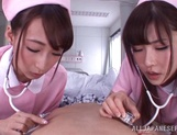 Appealing nurses Caire Hasumi and Anri Okita share hard cock picture 14