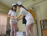 Lesbian nurses enjoying a quick oral together