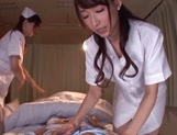 Lusty Asian nurses Caire Hasumi and Anri Okita play with cock