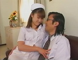 Kinky Japanese nurse blows cock on porn cam picture 1