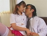Kinky Japanese nurse blows cock on porn cam picture 3