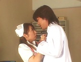 Sultry Japanese nurse in sexy white stockings is fucked by a horny doc picture 11