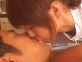 Sultry Japanese nurse in sexy white stockings is fucked by a horny doc picture 13