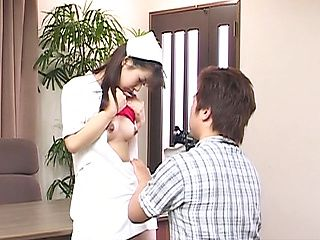 Delicious Asian nurse Akane Oozora strips and gets rear fuck